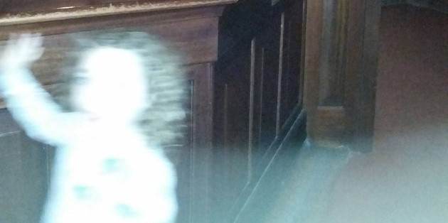 PIC FROM MERCURY PRESS (PICTURED: THE PHOTOGRAPH TAKEN BY LOUISE MURPHY IN WHICH SHE CLAIMS TO SEE A GHOST AT THE RIVERSIDE MUSEUM IN GLASGOW) A mum-of-two who was enjoying a family day at a museum was left spooked when she caught what she believes could be one of the clearest images of a GHOST on camera she has ever seen - a waving little girl. Louise Murphy had taken her nine-year-old son Owen for a day out at the Riverside Museum in Glasgow, Scotland, when she began taking photos in the museum's Victorian-themed street. Despite only Owen being near her when taking the picture, Louise was shocked to discover the haunting image of a little girl with long brown hair, waving at the camera and wearing a floral dress. Most eerily, her entire face is blanked out apart from what appears to be the hollow shape of a black eye looking directly at the camera. Louise, 30, claims Owen was also left unsettled by the image since he confirmed he was the only one present when she took the picture. SEE MERCURY COPY